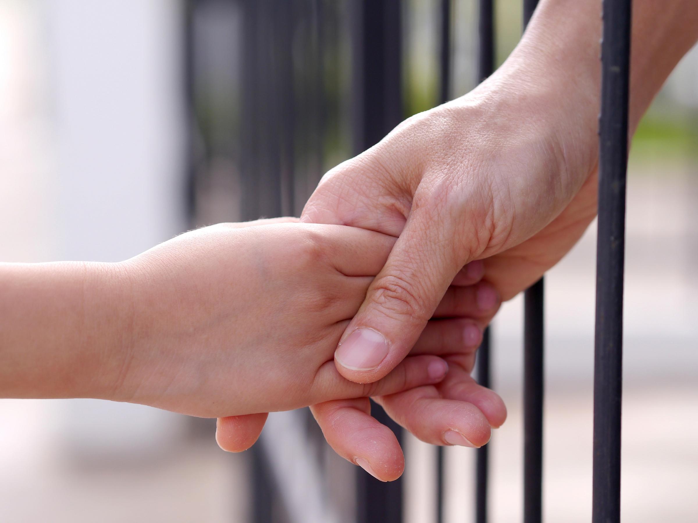prisoner and child fence