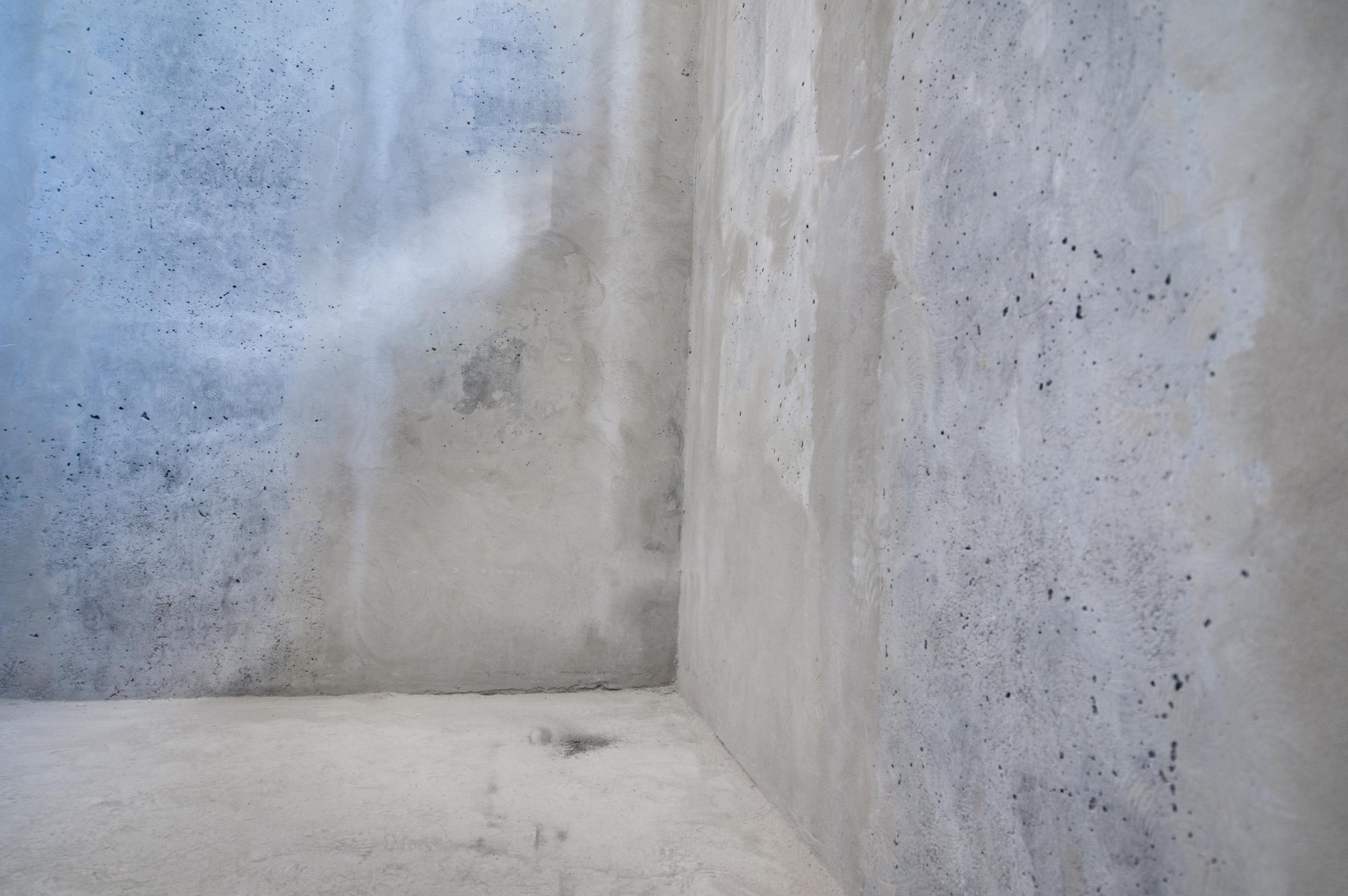 Concrete walls background, corner view.